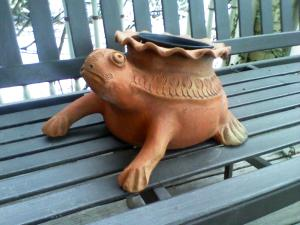 "The sad little tortoise planter sitting on our front porch swing seems to be thinking, ""When will spring be here?"".  He's going to have a long wait!"
