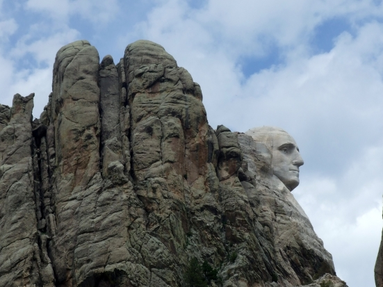 I took lots of photos of Mount Rushmore, but I chose this one in particular to show how the sculpted face of George Washington fits in with the surrounding rock face.  South Dakota