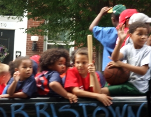 Children waving to parade-goers...