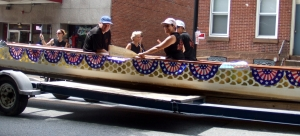 A dragon boat coming down the street